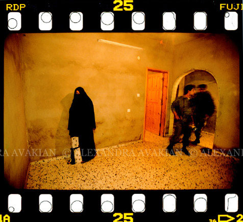 35mm film image of Palestinian police searching a Hamas home