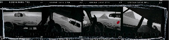 Contact strip showing several shots of the Great Pyramids as seen through the interior of a car