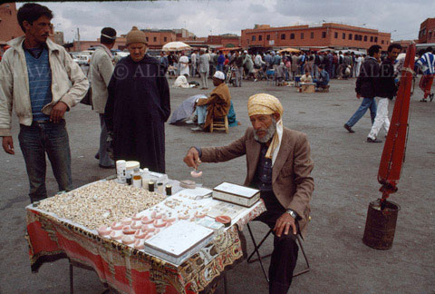 A street dentist sells his wares in Marrakesh
